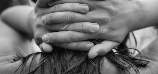 Close Up Of Woman With Hands Back On Neck
