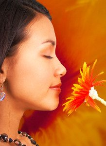 Relaxed Girl At Peace Smelling A Flower